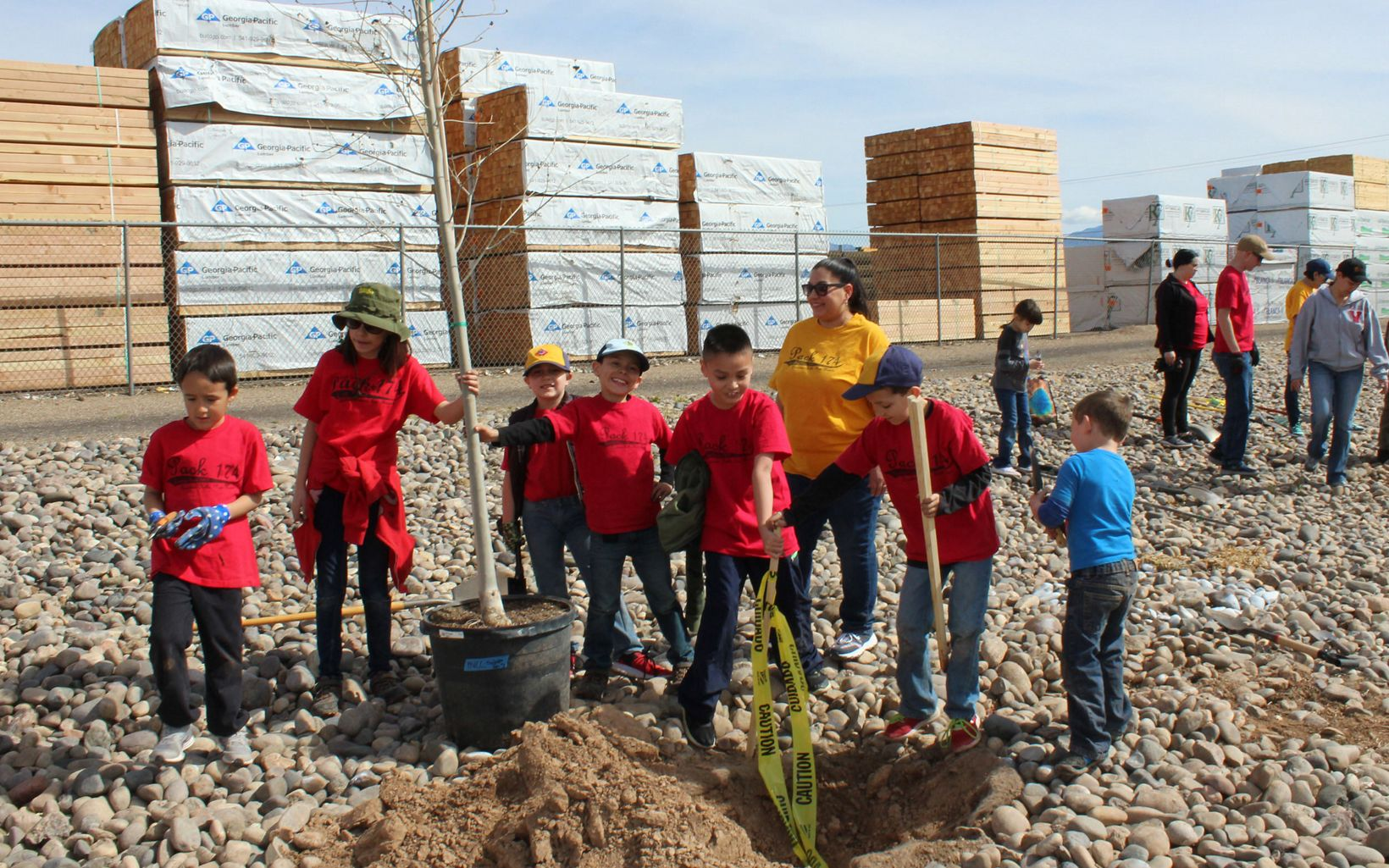 The pack planted native and desert adapted trees at the Mountain View Community Center.
