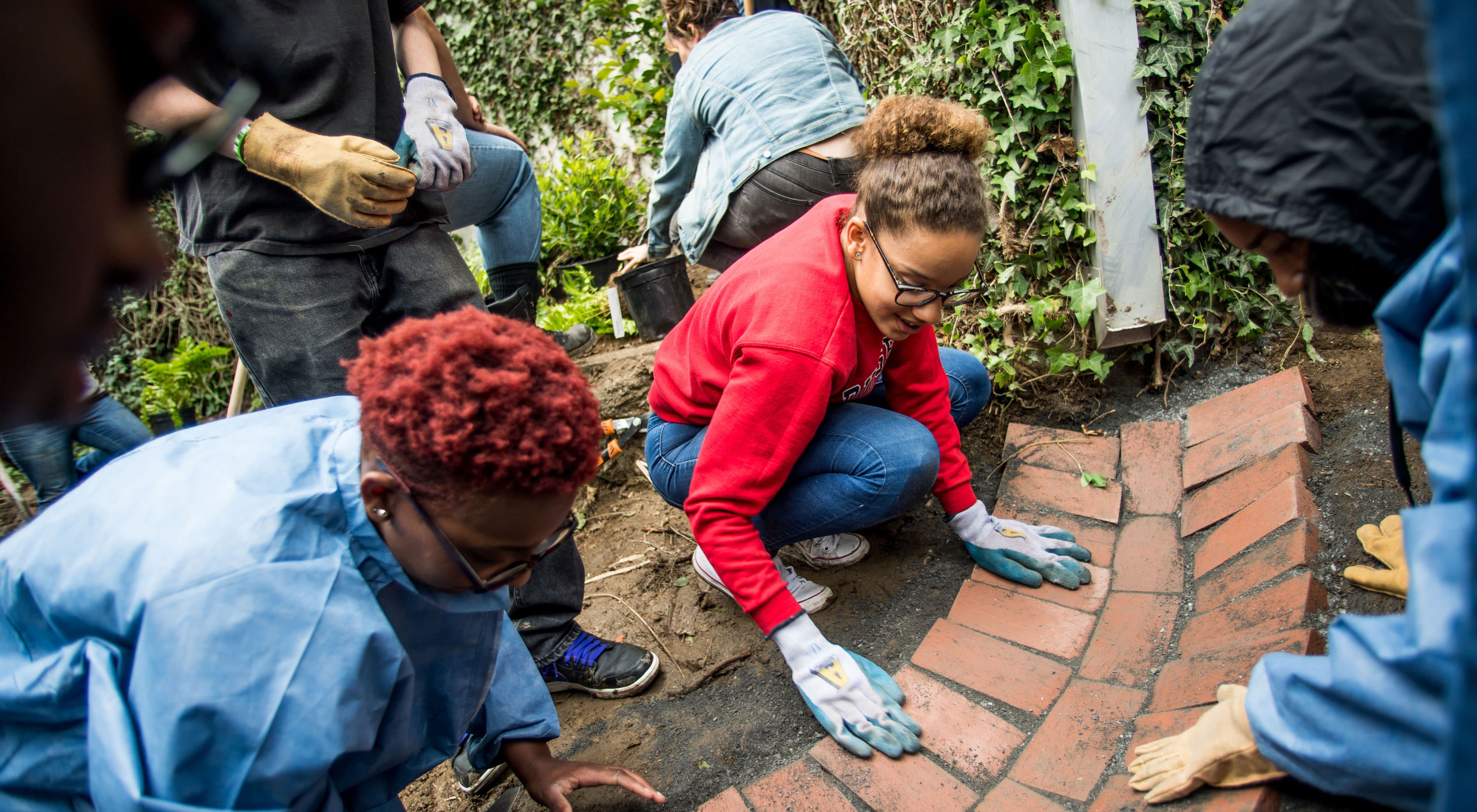 Students from WB Saul High School, a Nature Works Everywhere grant recipient construct a rain garden at their school in Philadelphia, PA.