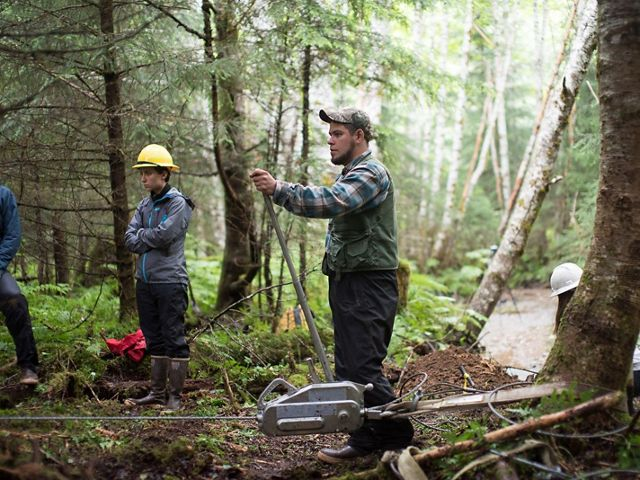 A local crew uses equipment to  restore a forest in Hoohah, Alaska.