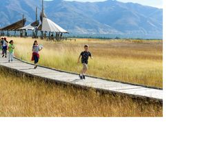 Children running on boardwalk of the Great Salt Lake