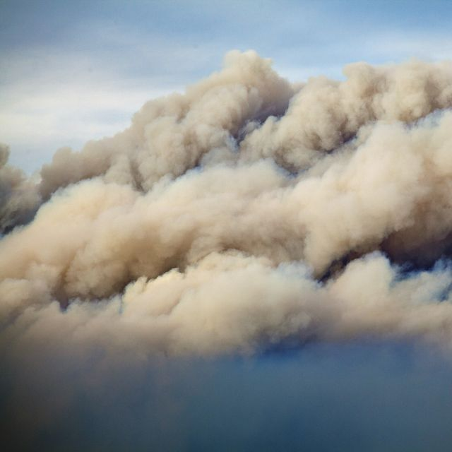 Smoke rises up during a devastating fire season in Australia. Climate change is contributing to these record fires.