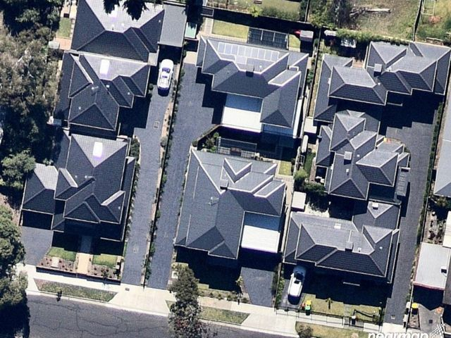 An aerial view of 8 houses and no tree canopy cover