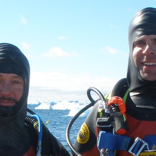 two men in diving gear