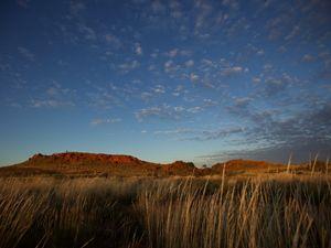 A desert under a darkening sky