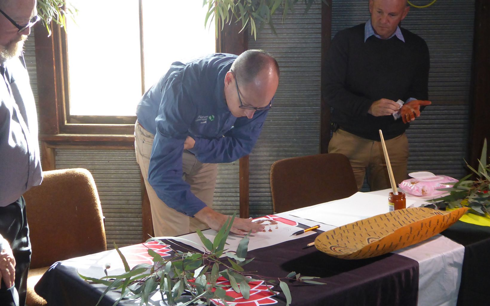 TNC Australia Country Director, Rich Gilmore adds his handprint to the Gayini Nimmie-Caira agreement, May 2018