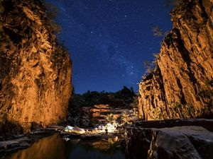 Camping under the stars in a remote sandstone gorge in the Northern Territory