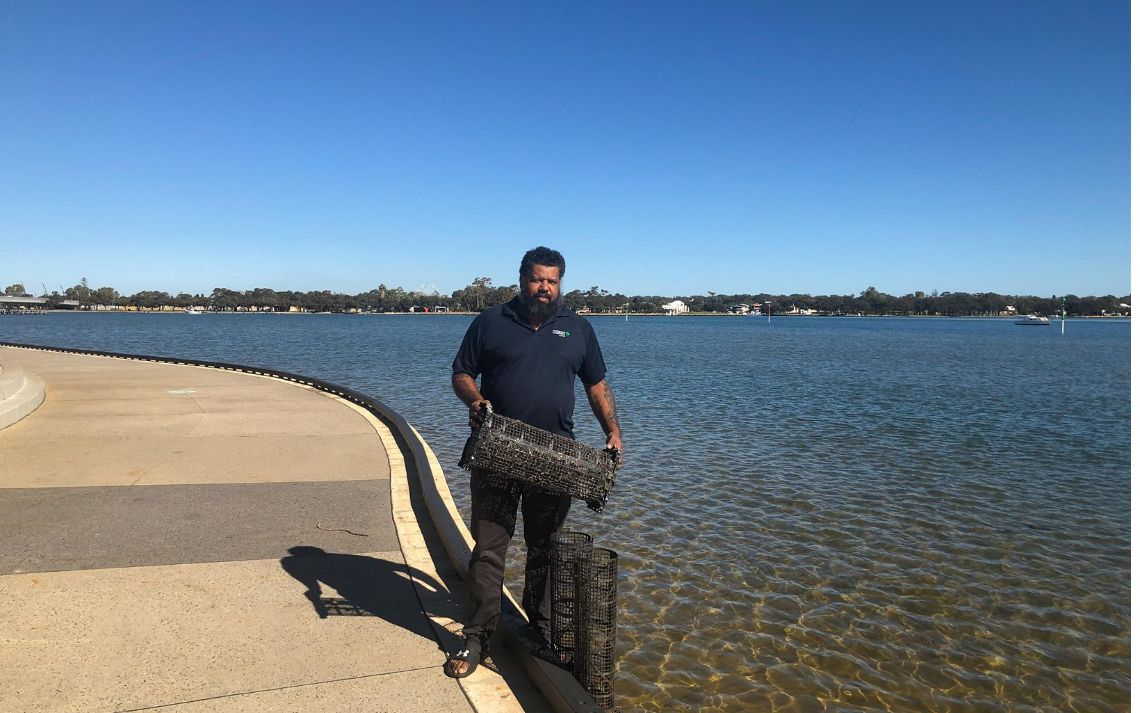 with mussel baskets besides the Peel-Harvey Estuary, Western Australia