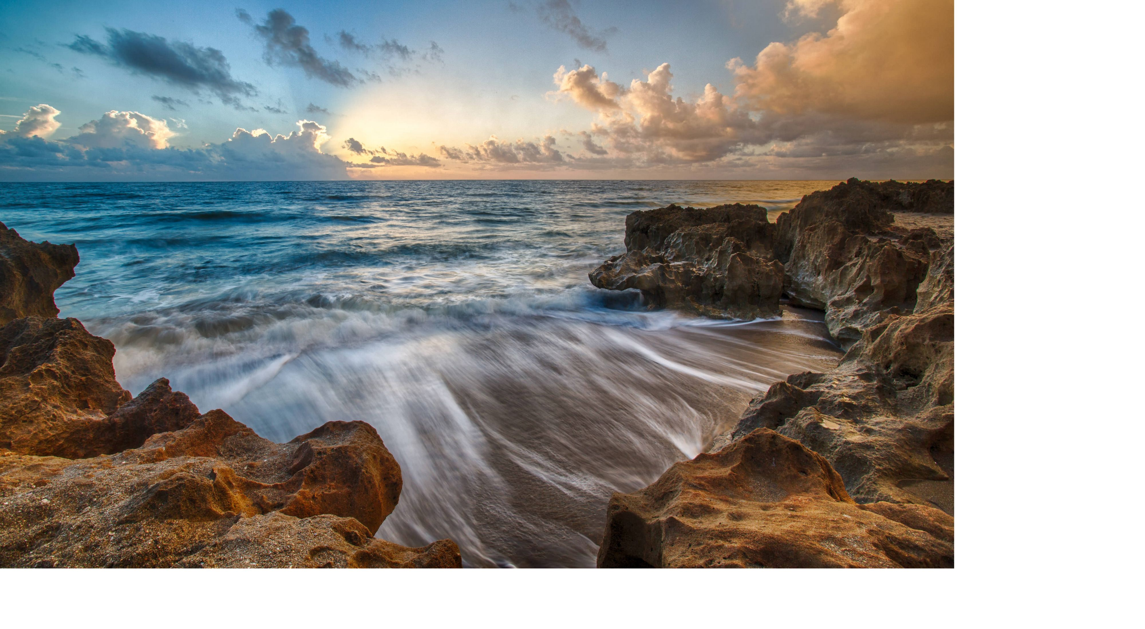 A timelapse photo of waves hitting a rocky shore