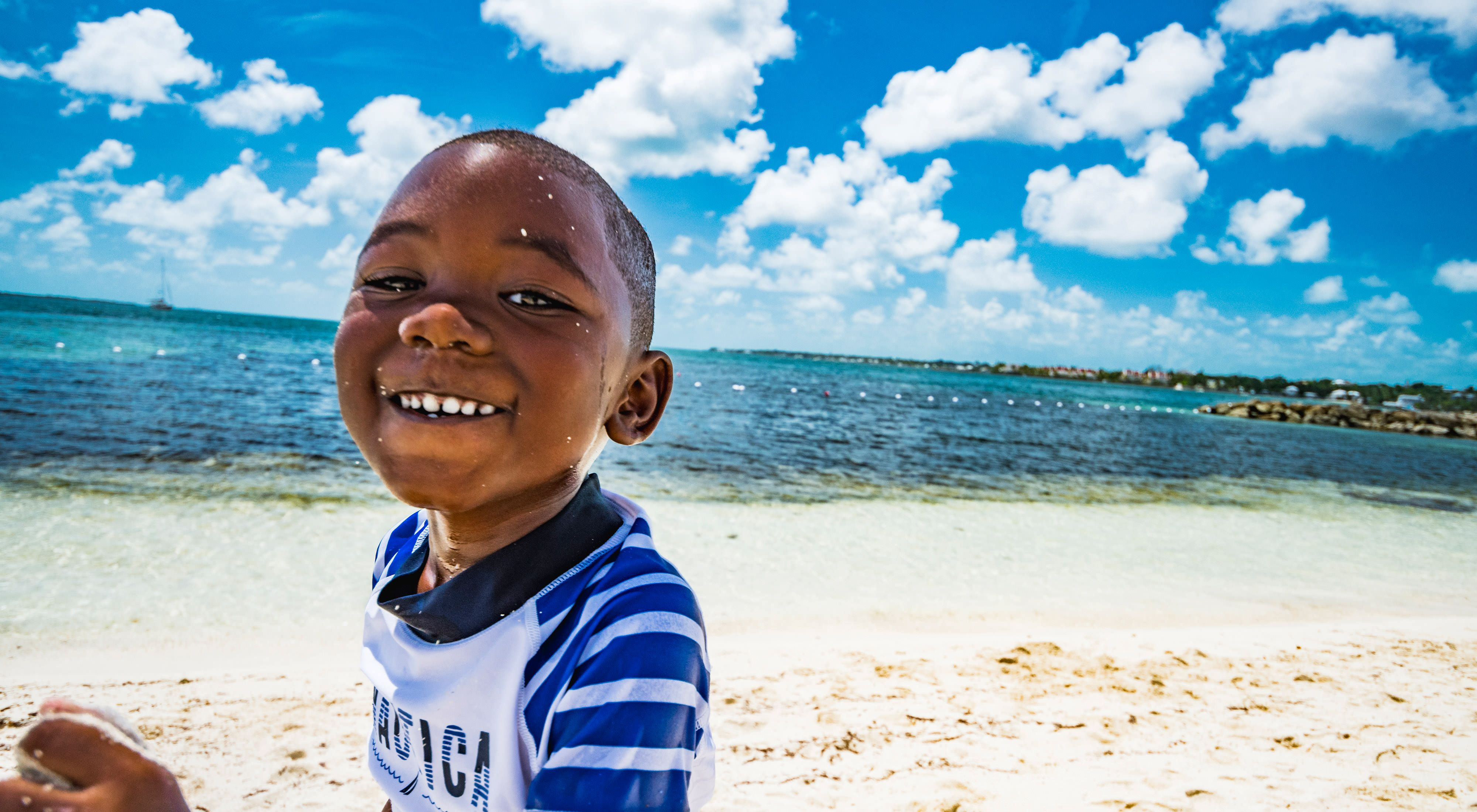 A boy plays on a beach in The Bahamas.
