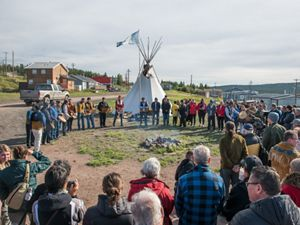 people stand in a circle in Lustel K'e Dene Northwest Territories to celebrate Thaidene Nene