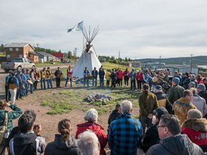 A group stands in a ceremonial circle in Łutsël K'é, Northwest Territories to celebrate Establishment Agreements for Thaidene Nëné.