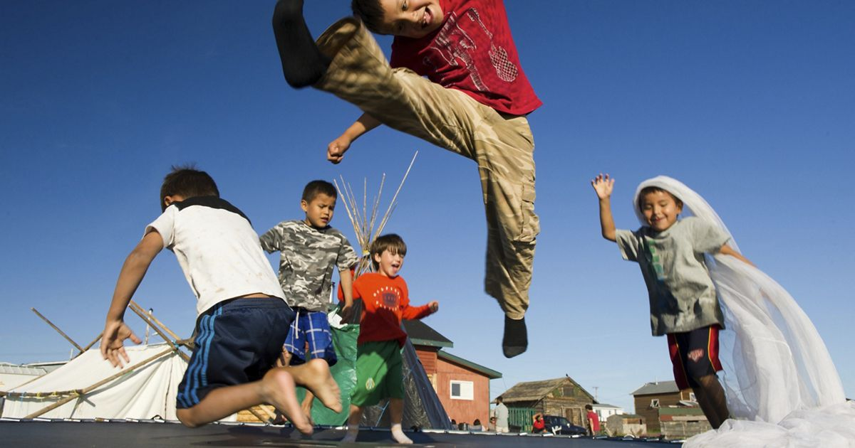 a group of kids playing and jumping