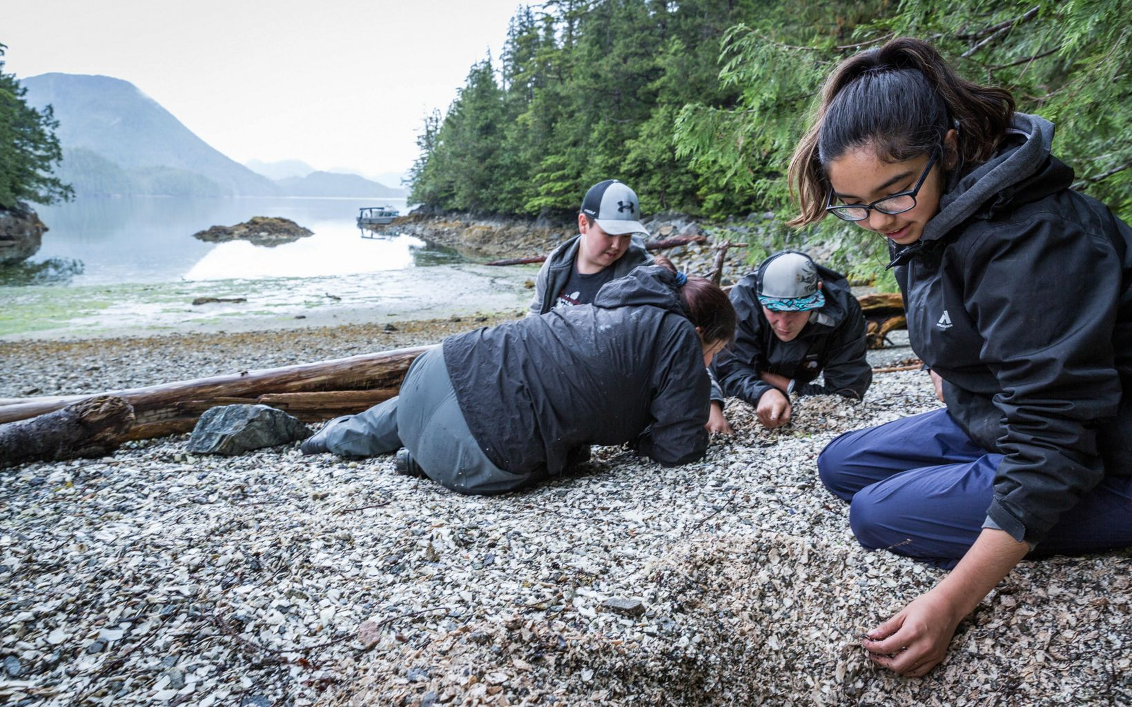 SEAS interns dig through an ancient shell midden site looking for artifacts in the Kitasoo/Xai'xais Nation of the Great Bear Rainforest.
