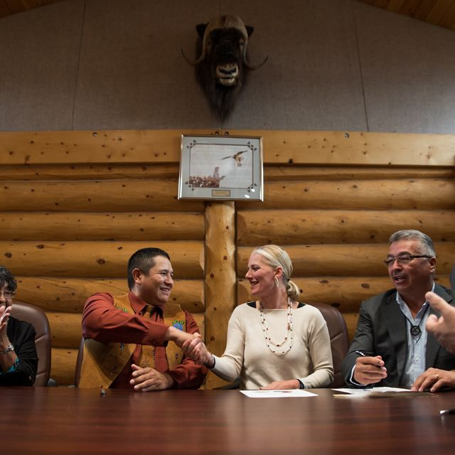 Minister of Environment Catherine McKenna and Łutsël K'e Dene First Nation Chief Darryl Marlowe celebrate after signing agreements to establish Thaidene Nëné.