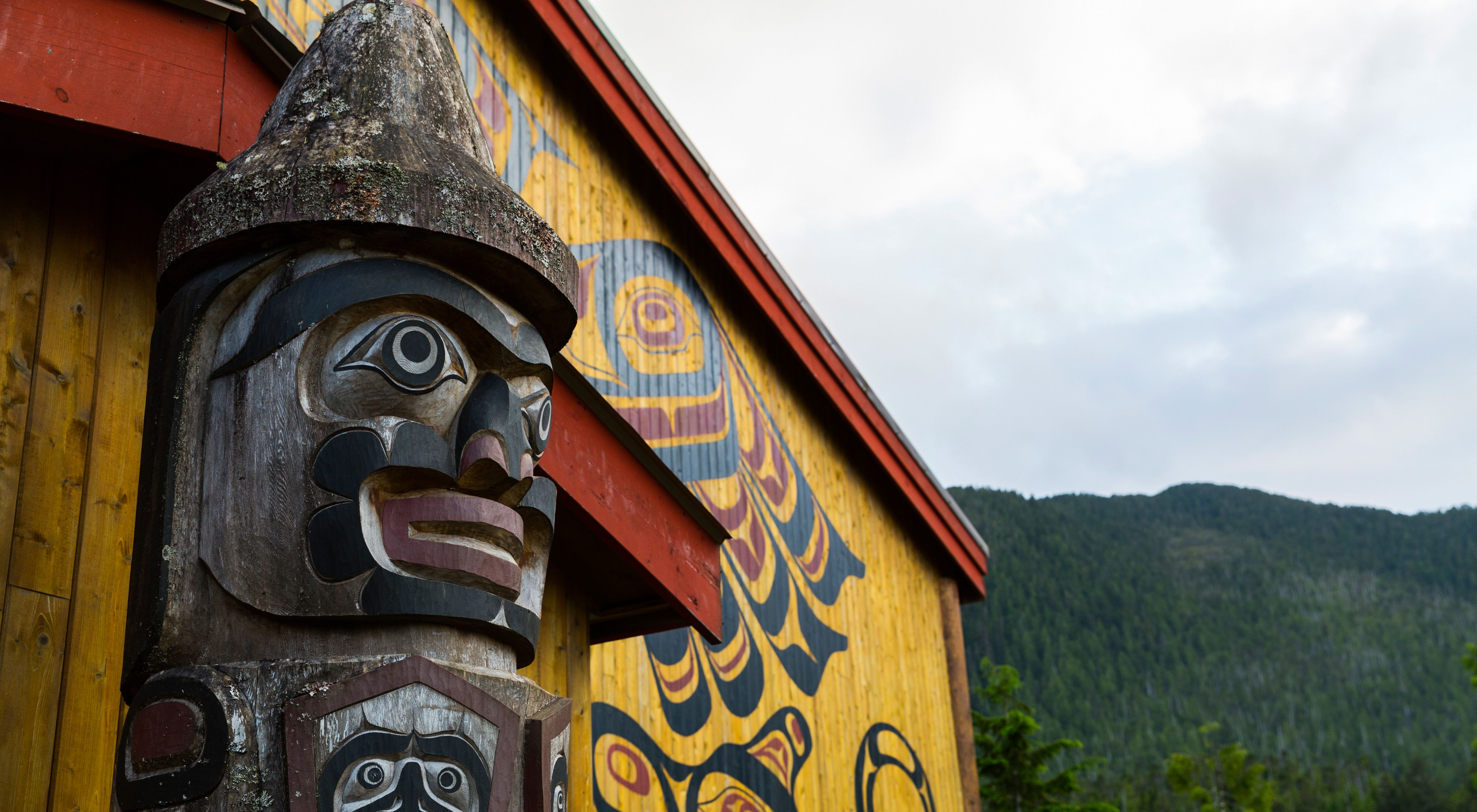 watches over the village of Klemtu from in front of the Kitasoo/Xai'xais Big House in Klemtu, BC.