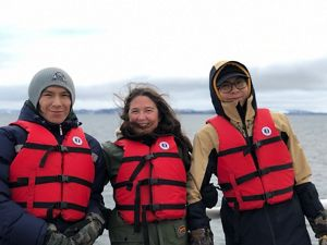 Northwest Territories lead Tracey Williams (center) with students Tyson Marlowe and Nalze Catholique, who joined the maiden voyage of the Nahidik research vessel.