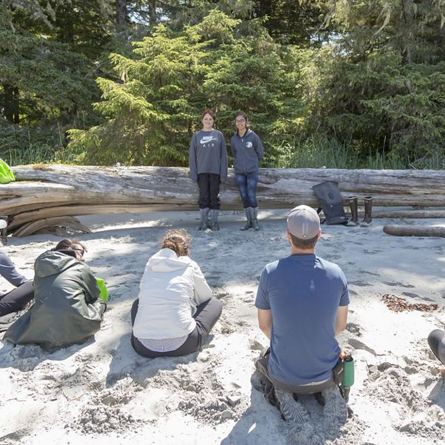 SEAS students Tina Lobbes and Mercedes Robinson retell a traditional story to an audience of Nature United and Tides Canada staff and donors in Dis'ju, Great Bear Rainforest.
