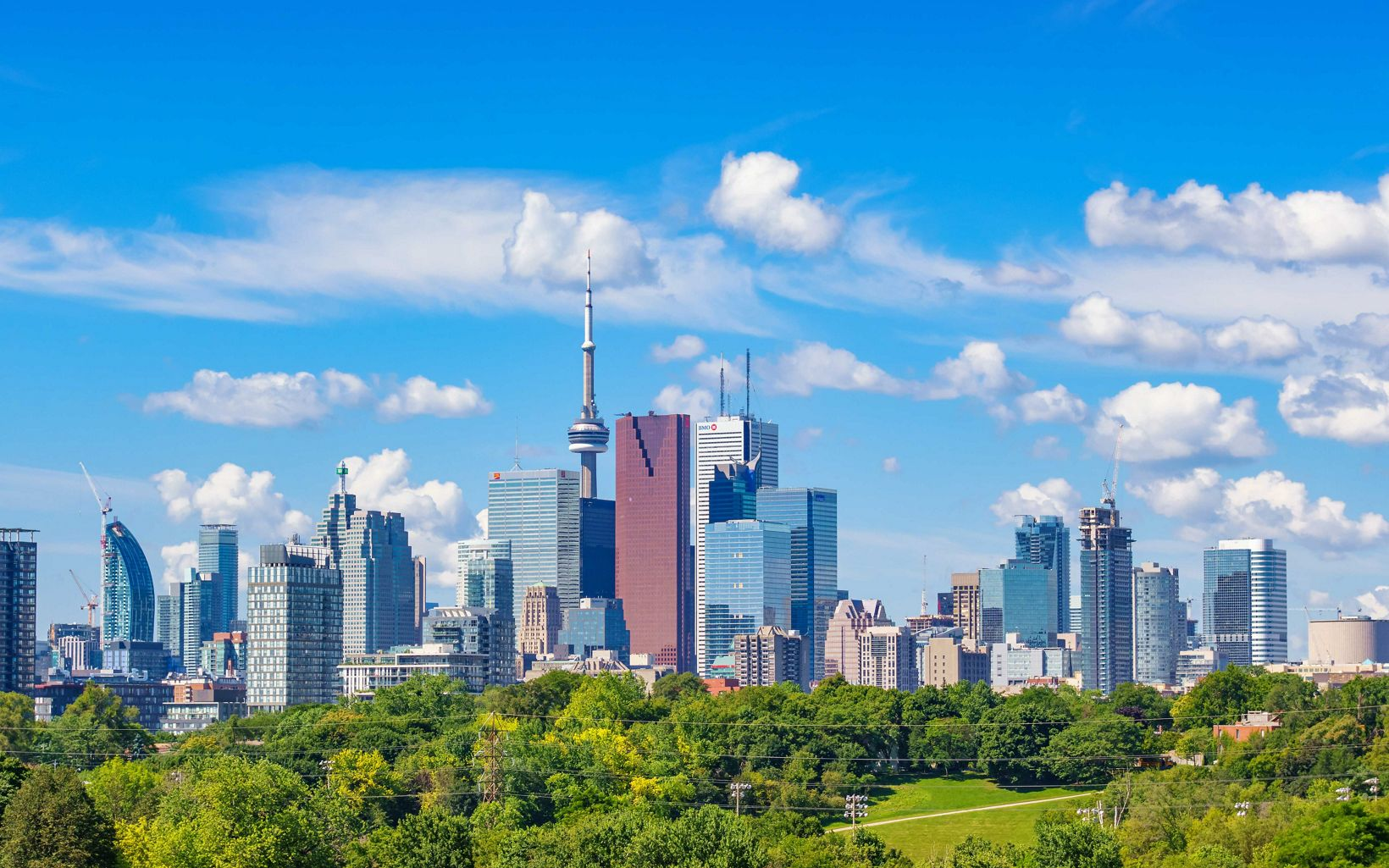 Photo of the skyline of downtown Toronto Ontario Canada on a sunny day.