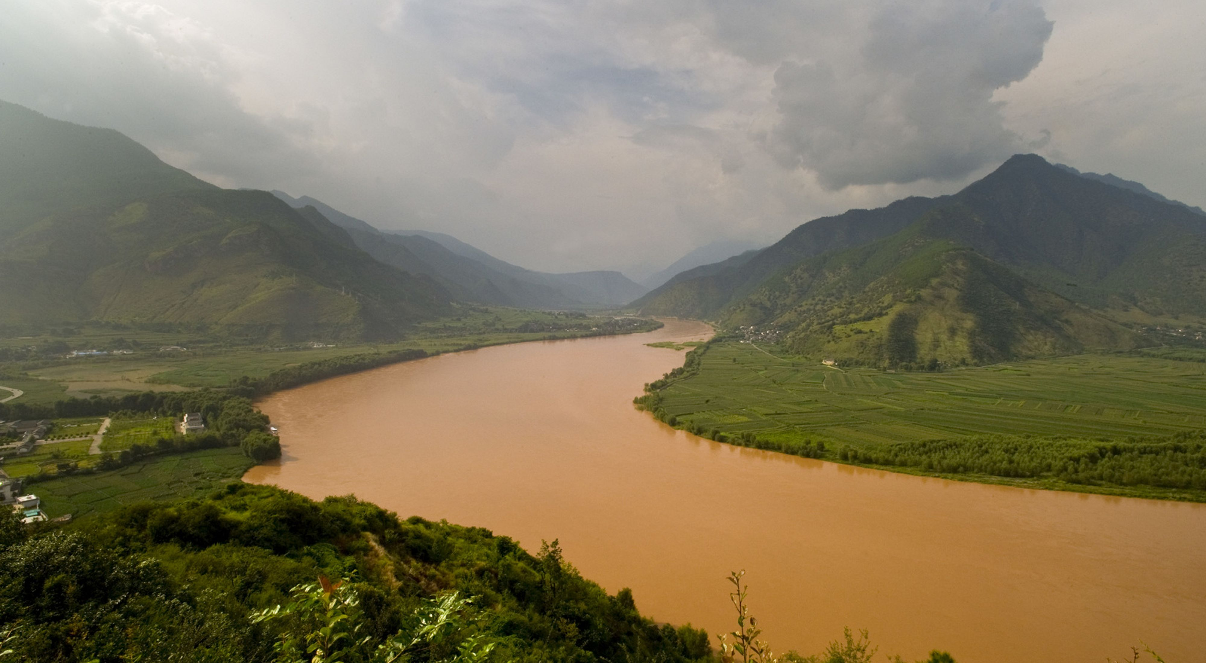 Recent rain turns the river a muddy-brown, viewed at a bend in the upper Yangtze River (Chang Jiang), Yunnan province, southwestern China. The Conservancy is working with the Chinese government to increase protection of Yunnan's natural areas by establishing a system of national parks.