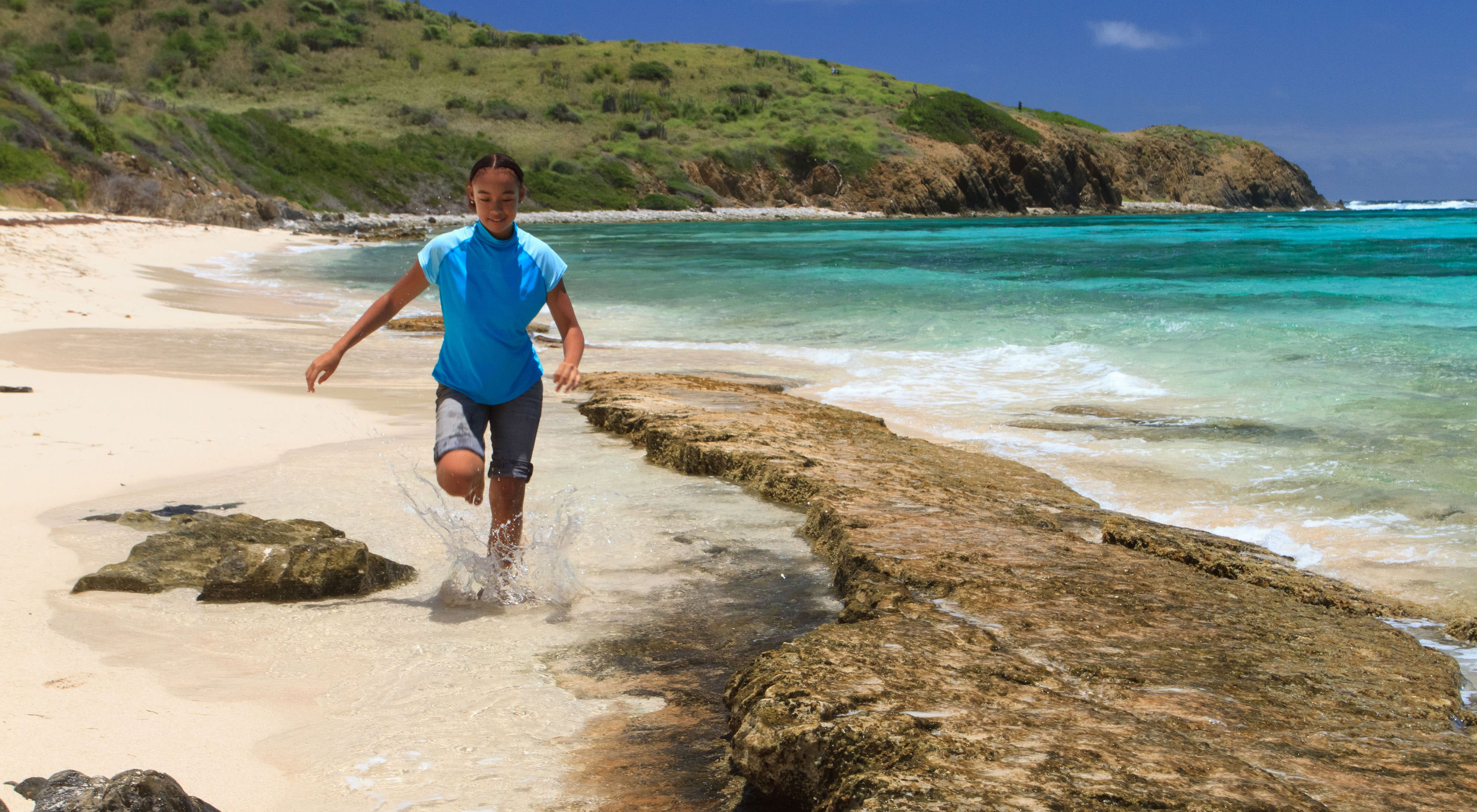 A girl runs along the beach at Jack and Isaac Bay Preserve in St. Croix, U.S. Virgin Islands.