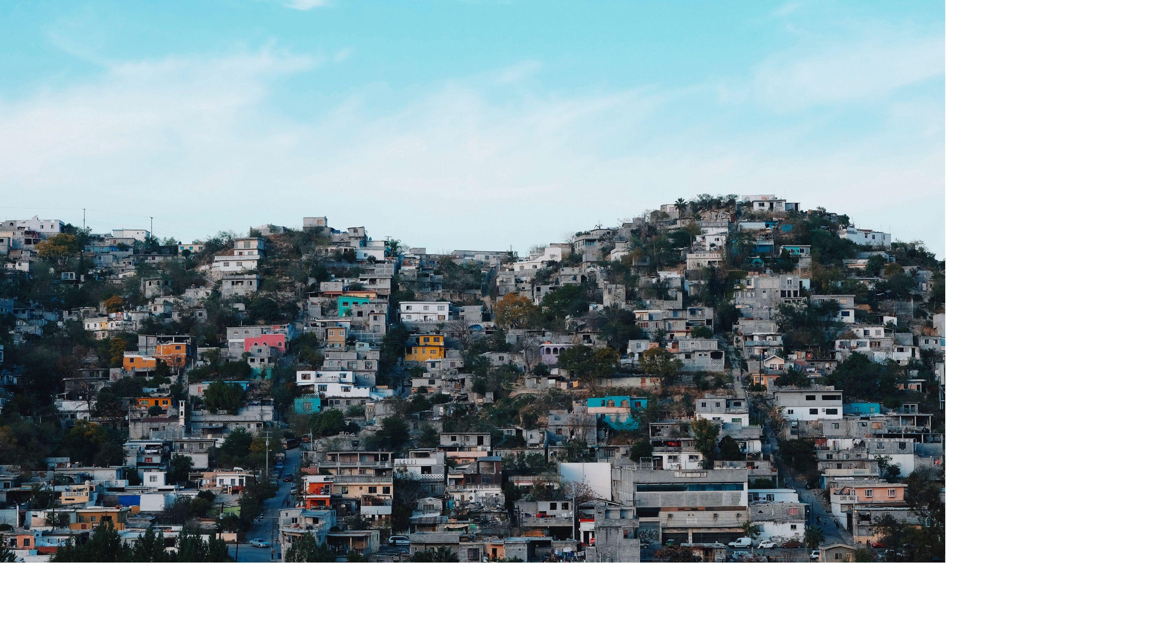 Developed hillsides loom over the city of Monterrey.