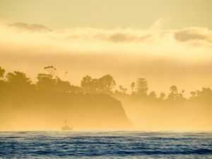 Fishing boat in the fog off the California coast.