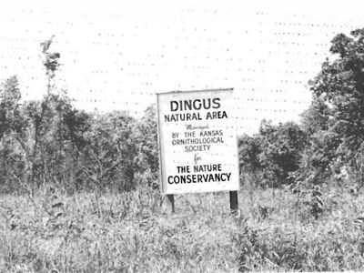 Black and white photo of metal preserve sign.