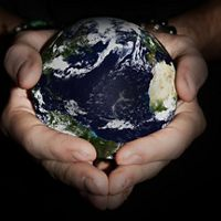 Hands holding the globe of the Earth.