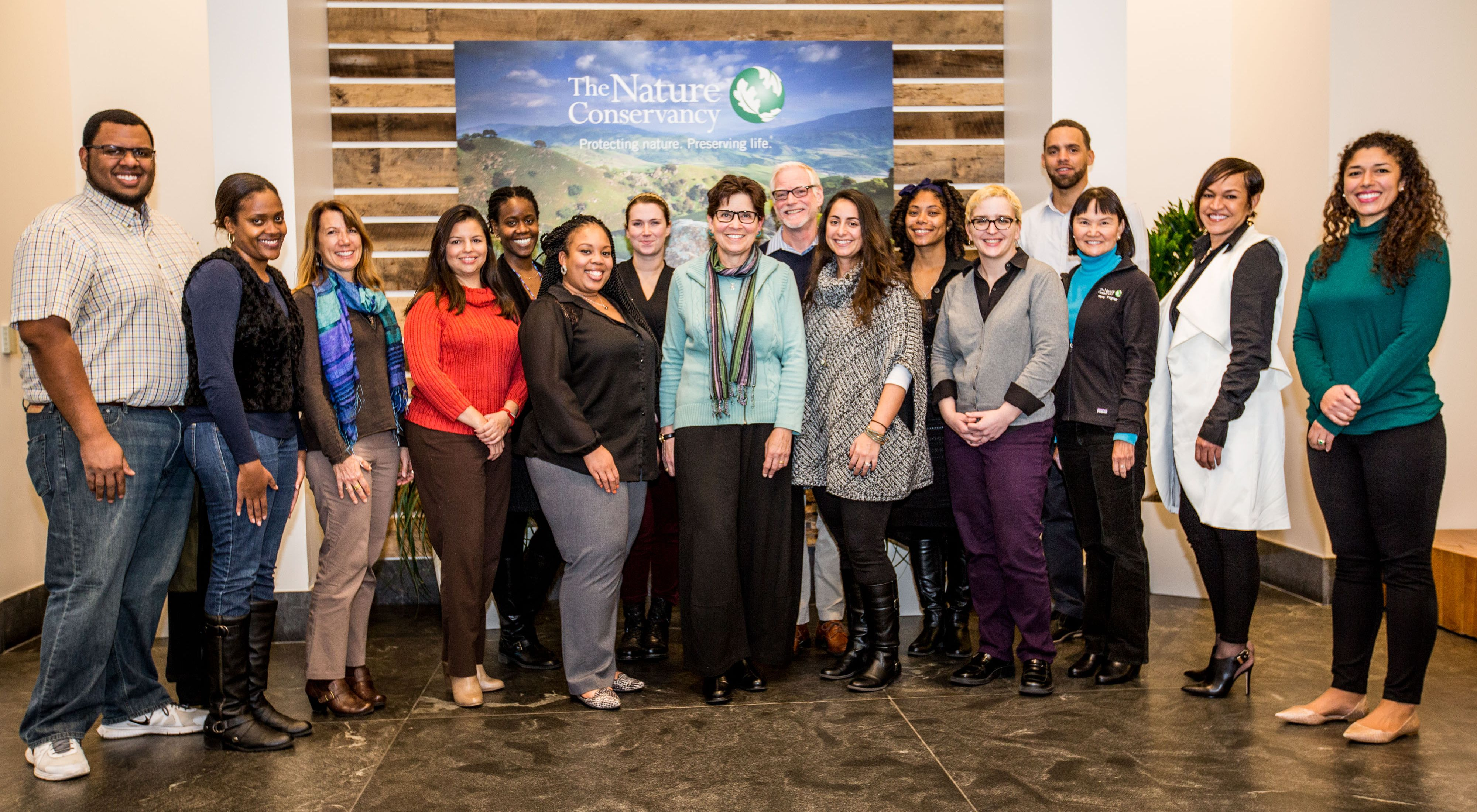 The 12 member Employee Resources Group Steering Committee poses at the Worldwide Office.