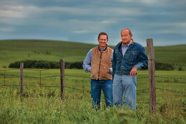 Photo of Ford Drummond and his father in open grasslands.