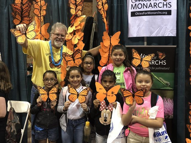 Kids and teachers decorate paper monarch butterflies with TNC and Okies for Monarchs during the Wildlife Expo in Guthrie in September.