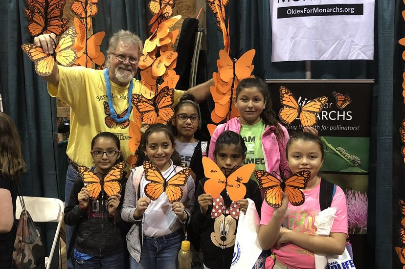 Group of young girls holding their decorated monarch butterflies.