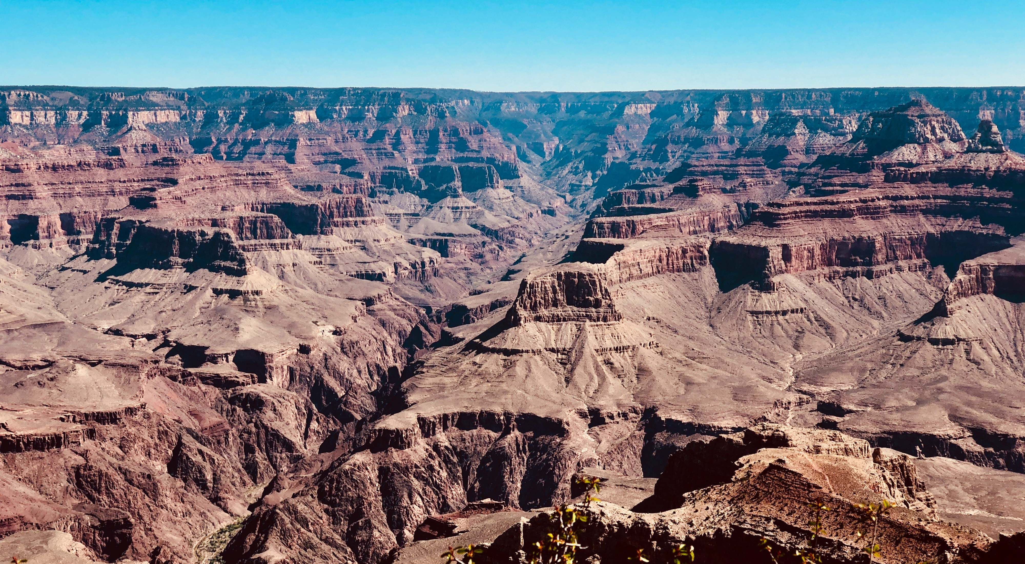 View from the rim of the grand canyon, with rock terraces as far as the eye can see.