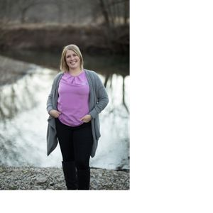 Heidi stands in front of an unnamed creek in the Flint Hills.