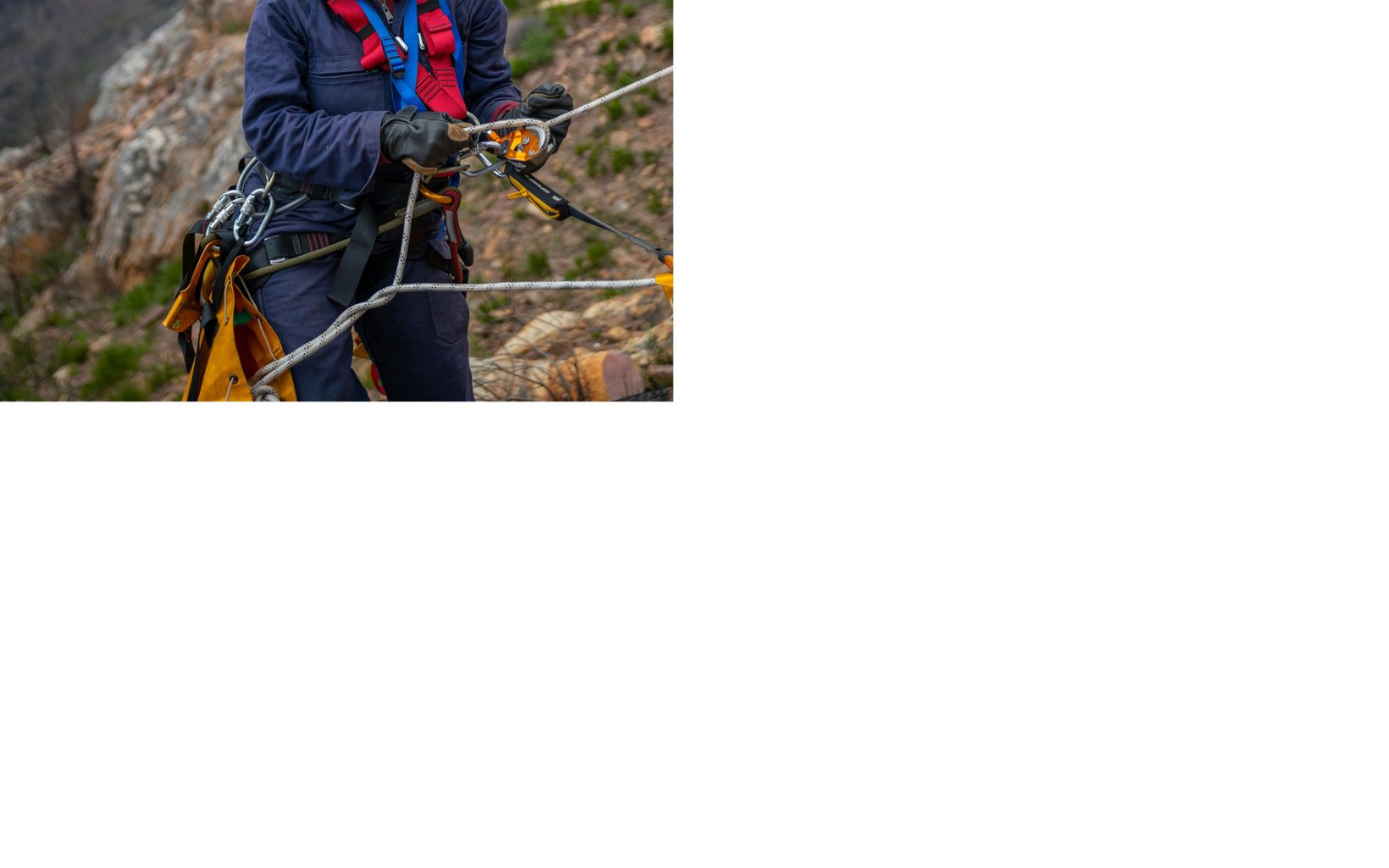 Nelisiwe (Nelly) Mthembu repels down the mountain near Cape Town. The high elevation team is first flown up the mountain in a helicopter and spends several days working.