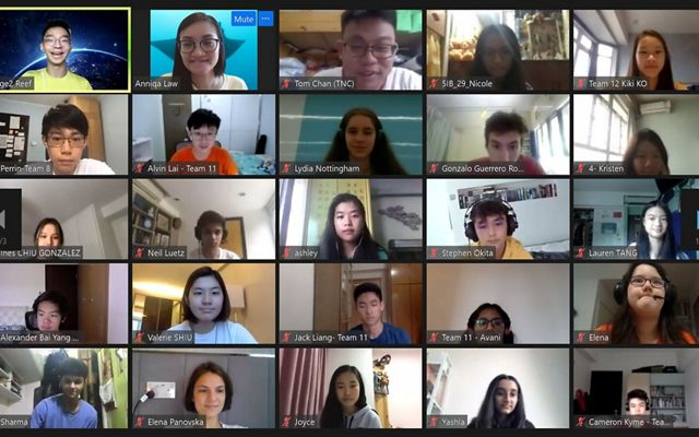 A screen capture of an online webinar that shows many students faces in a grid.