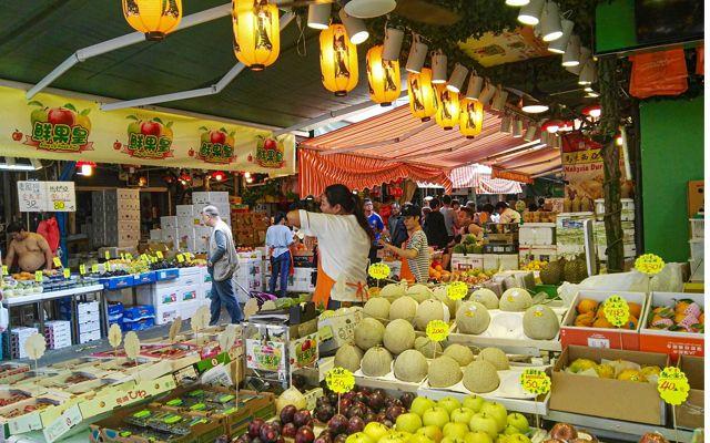An open air fruit market in Hong Kong.