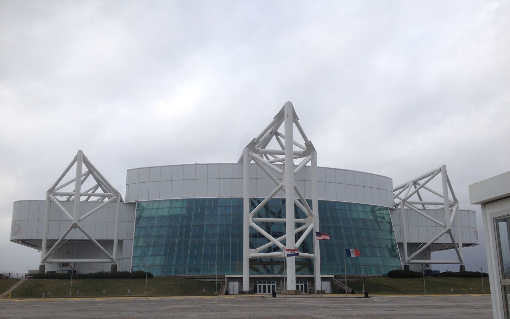 A large glass and white steel building.