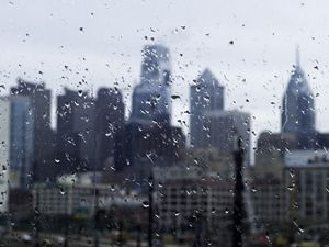 View of the Philadelphia skyline through a rainy window