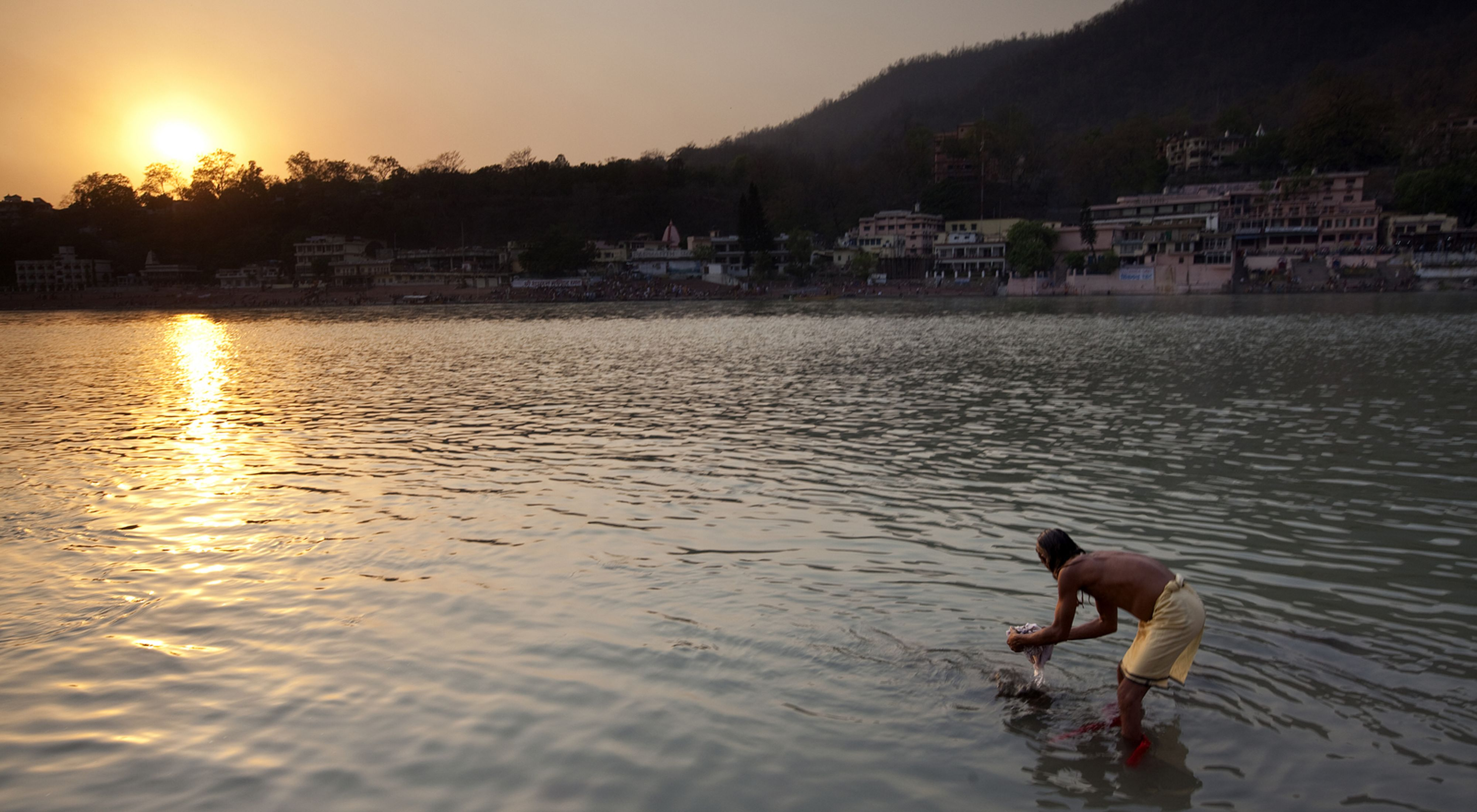 In Rishikesh, India, pilgrims bathe and gather at the Ganges River as part of the Kumbh Mela gathering.