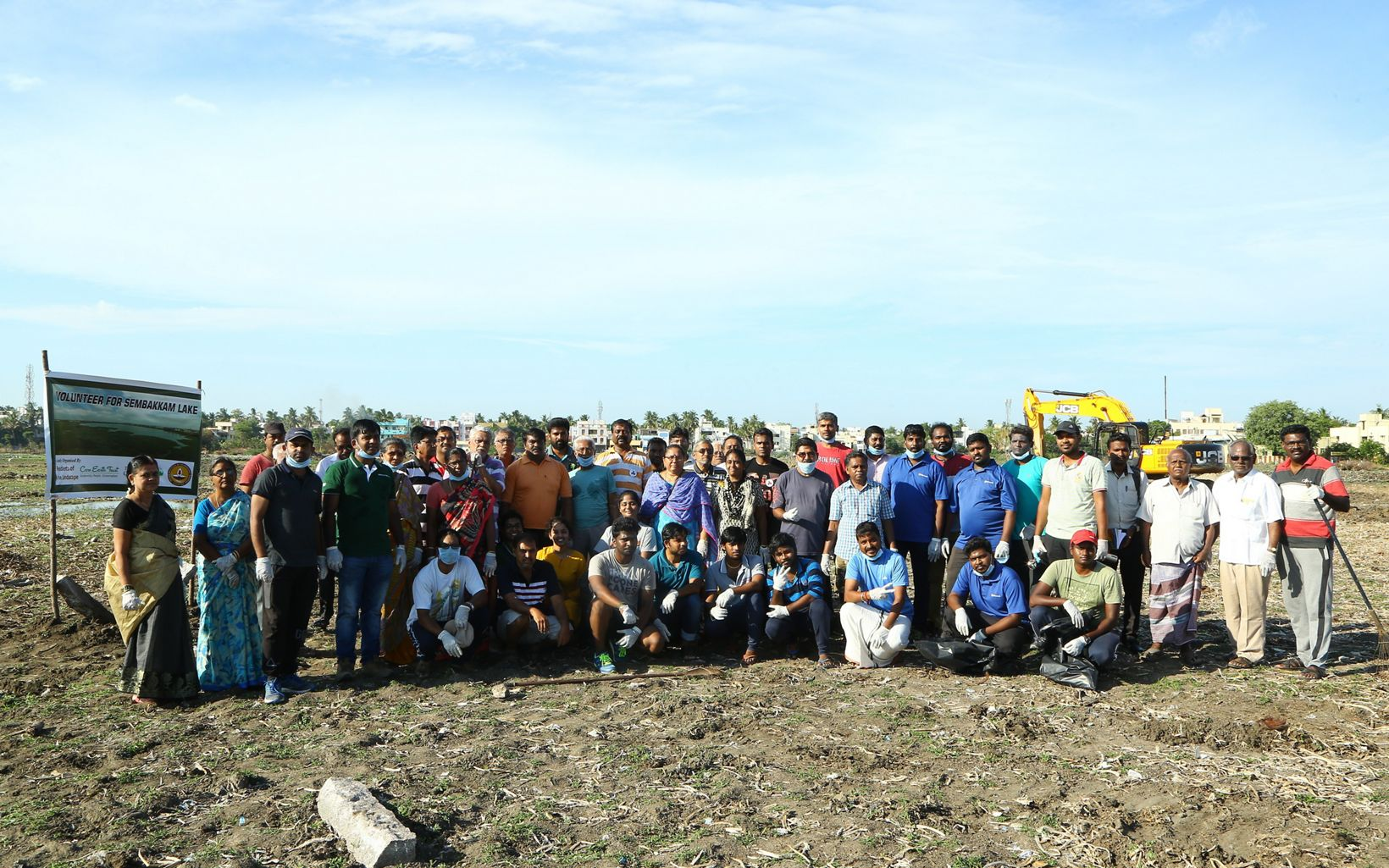 volunteers along with the project team gathered for the Lake Sembakkam clean up drive