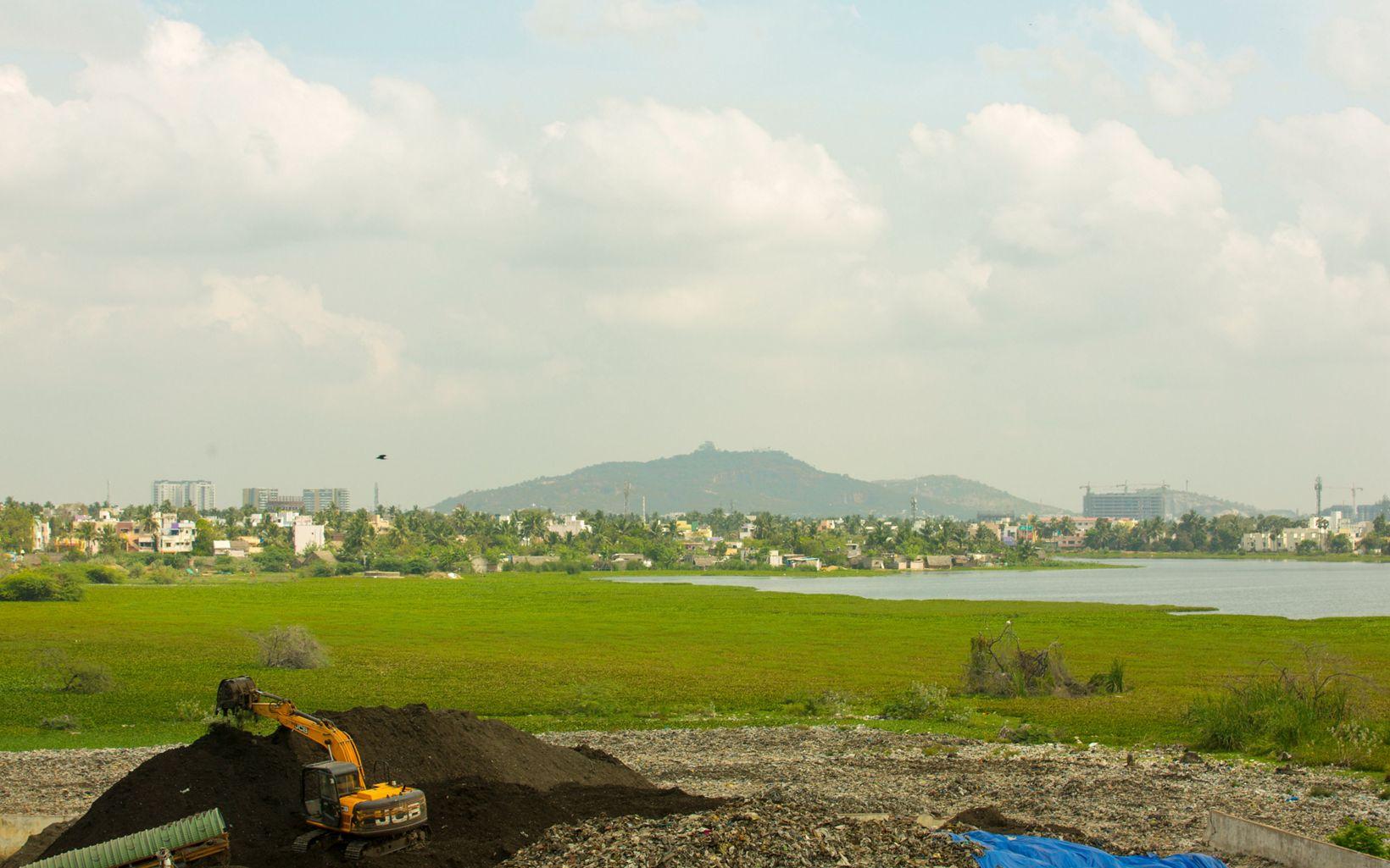 using excavators at Lake Sembakkam