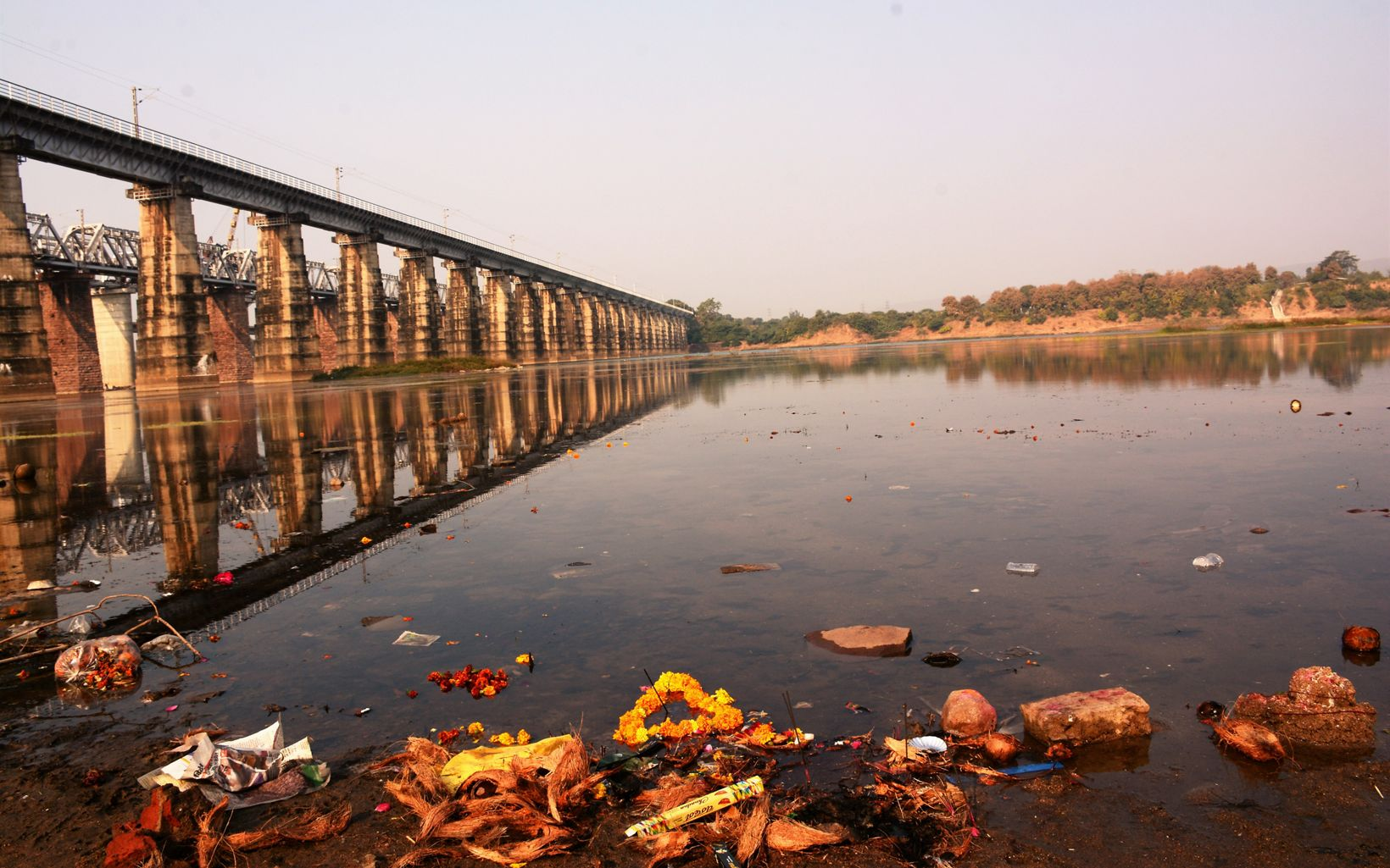collecting on sides of River Narmada