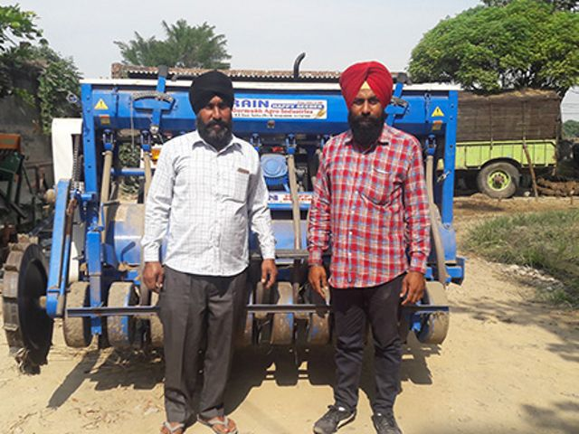 Farmer Parwinder Singh at his field ready to use the Happy Seeder.