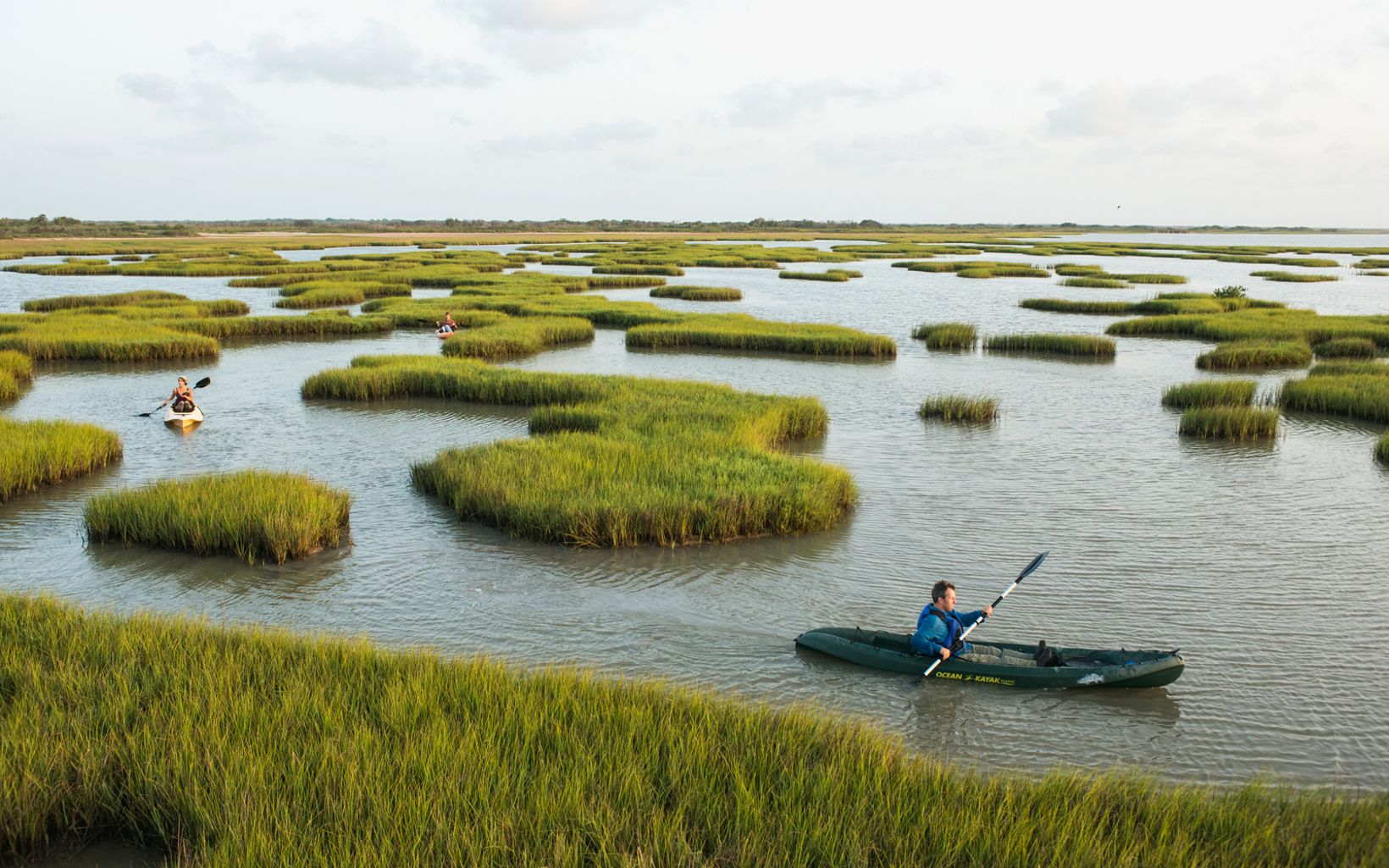 Rich Kostecke, director of science for the Nature Conservancy in Texas, paddles through marsh off the coast of TNC's Powderhorn Ranch, near Port O'Connor, Texas. The ranch is one of the largest remaining tracts of unspoiled coastal prairie in the state of Texas.