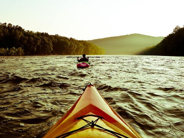 A river seen from the perspective of a kayak.