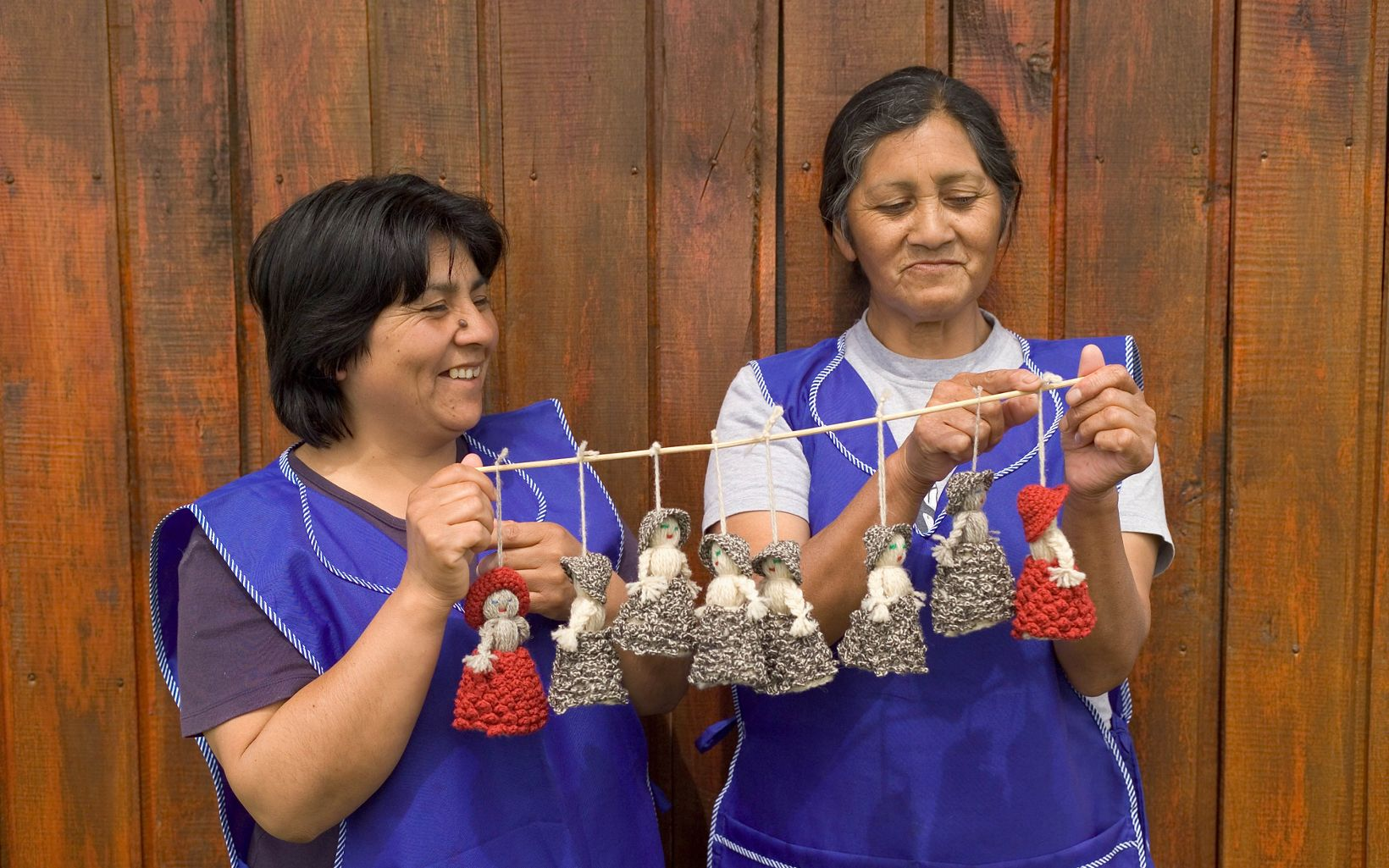 Fresia, (left), Inerta, (on right), display their knitted  dolls. They are members of the Kutralhue de Huiro women's cooperative at the Huiro indigenous community bordering the Reserva Costera Valdiviana.  The Nature Conservancy's Reserva Costera Valdiviana, (Valdivian Coastal Reserve), is a 147,500 acre site comprising temperate rainforest and 36km of Pacific coastline south of Valdivia, Chile.