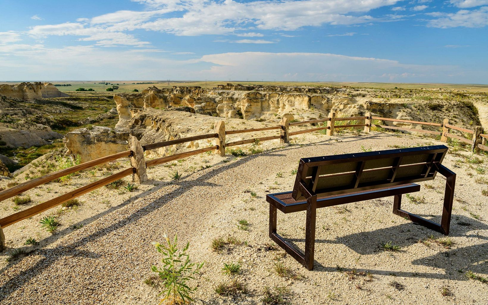 Take a moment to stop at Little Jerusalem Badlands State Park. The Rockies might take your breath away, but the spacious Kansas landscape will give it back again.