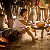 in a family cooking hut at the ejido Veinte de Noviembre in in the lush Maya Forest of Mexico's Yucatan Peninsula.