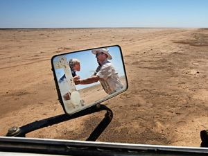 BALRANALD, NSW, AUSTRALIA - FEBRUARY 7: Simon Booth plays with his kids, Claire and Ryan in a dried up paddock on their farm February 7, 2008 in Balranald, New South Wales, Australia. Simon traveled out to his fields to see how the rainstorm the day before had affected his land. One area had received just under 2 inches (184 points), which was the most rain in one incident in over 10 years for his station. Booth remembers when he grazed 250 head of cattle in this paddock, a sight his children Ryan and Claire may never see. The Murray-Darling Basin of Australia has been plagued with severe drought since the late 1990's and many growers and policy makers are being forced to work on implementing more efficient irrigation systems. (Photo by Amy Toensing)